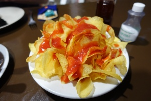 No, that's not ketchup on Lay's Potato Chips...but that's what we thought when they first arrived at our table!  The chips had an amazing hot sauce on them and the chips certainly did not taste like they were bagged.