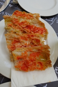 A common Tapas; tomato bread.  Simply, this is grated tomato spread on bread.  The better the bread and higher the quality of tomato used will result in a simple but flavor packed appetizer and this serving consisted of both.  Perfect for sopping up the olive oil based juices that were left behind in some of our other Tapas dishes.